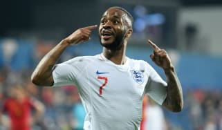 England star Raheem Sterling reacts to the crowd after scoring in the 5-1 win against Montenegro
