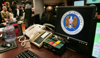 Fort Meade, UNITED STATES:A computer workstation bears the National Security Agency (NSA) logo inside the Threat Operations Center inside the Washington suburb of Fort Meade, Maryland, intell