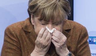 Angela Merkel sneezes