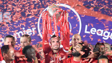 Liverpool captain Jordan Henderson lifts the Premier League trophy