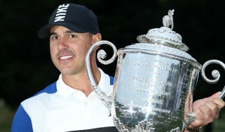 Brooks Koepka poses with the Wanamaker Trophy after winning the 2019 PGA Championship