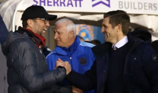 Liverpool manager Jurgen Klopp shakes hands with Shrewsbury Town boss Sam Ricketts