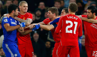 Diego Costa of Chelsea clashes with Liverpool FC players