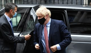 Boris Johnson leaves Downing Street to deliver his address to the virtual Conservative Party conference.
