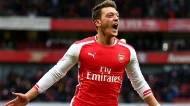 Mesut Ozil celebrates after scoring for Arsenal during the match between Arsenal and Aston Villa