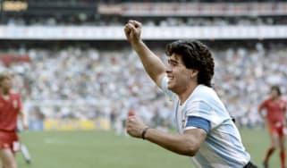 Diego Maradona celebrates after scoring a goal for Argentina.