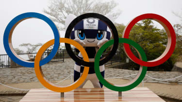 Tokyo 2020 mascot Miraitowa poses with the Olympic rings