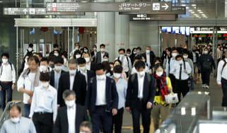 Commuters at Nagoya railway station last week