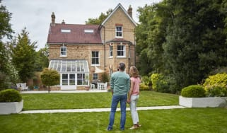 Couple looking at country house