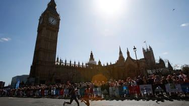 LONDON, ENGLAND - APRIL 13:Mo Farah of Great Britain (L) and Emmanuel Mutai of Kenya run past the Houses of Parliament during the Virgin Money London Marathon on April 13, 2014 in London, Eng