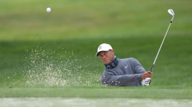 Tiger Woods plays out of the bunker during a PGA Championship practice round at TPC Harding Park