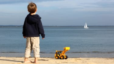 A child stands on the beach in Arcachon on October 19, 2013, southwestern France. AFP PHOTO / NICOLAS TUCAT(Photo credit should read NICOLAS TUCAT/AFP/Getty Images)