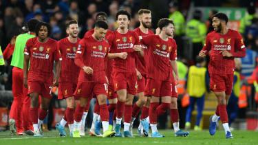 Curtis Jones (centre) celebrates the winning goal with his Liverpool team-mates
