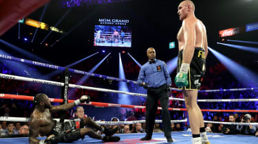 Tyson Fury knocked down Deontay Wilder in the third round of their WBC title rematch