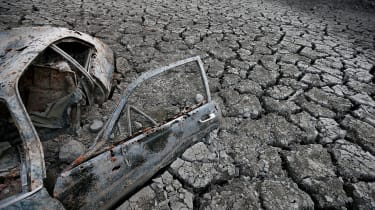 SAN JOSE, CA - JANUARY 28:A car sits in dried and cracked earth of what was the bottom of the Almaden Reservoir on January 28, 2014 in San Jose, California. Now in its third straight year of