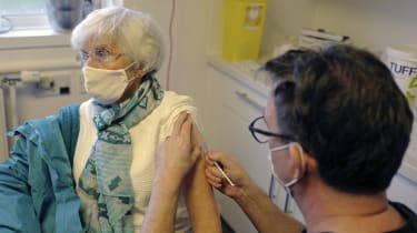 A GP administers the Covid-19 vaccine to a patient in Falmouth, Cornwall.