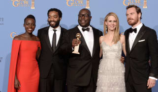 BEVERLY HILLS, CA - JANUARY 12:(L-R) Actors Lupita Nyong'o and Chiwetel Ejiofor, director Steve McQueen, actors Sarah Paulson and Michael Fassbender, winners of Best Motion Picture - Drama fo
