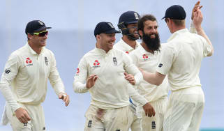 England players congratulate bowler Moeen Ali after he dismissed Niroshan Dickwella