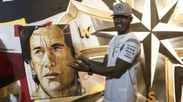 Mercedes driver Lewis Hamilton received a painting of the late F1 legend Ayrton Senna at the 2016 Brazilian GP
