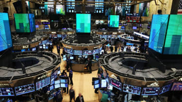 Traders work the floor of the New York Stock Exchange