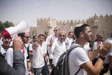 Israeli Jewish men walk by Damascus Gate during Jerusalem Day celebrations