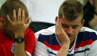 England fans look dejected after England's defeat by Uruguay
