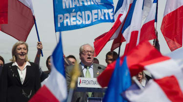Jean-Marie Le Pen (L) and Marine Le Pen (R) stand on stage during French National Anthem