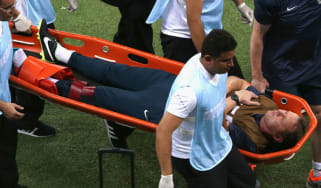 England trainer Gary Lewin is stretchered off the field