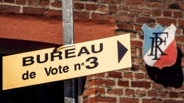 A Front National emblem points the way to a polling station