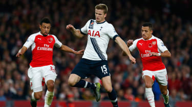 Eric Dier battles for the ball with Francis Coquelin and Alexis Sanchez