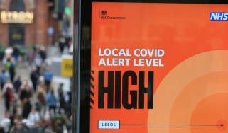 A bus stop in Leeds displays a sign warning that the Covid risk is high in the city.