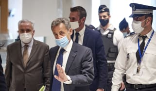 Nicolas Sarkozy arrives at court for the verdict of his trial for corruption
