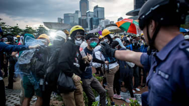 HONG KONG - DECEMBER 01:Pro-democracy protesters clash with police outside Hong Kong's Government complex on December 1, 2014 in Hong Kong. Leaders from the Federation of Students called on f