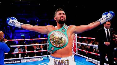 Tony Bellew celebrates after winning the WBC Cruiserweight Championship belt in Liverpool