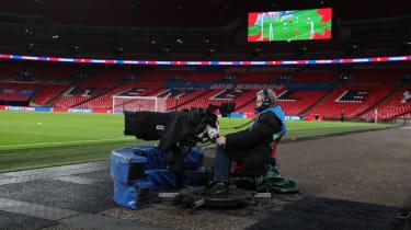 A TV cameraman at Wembley Stadium in London