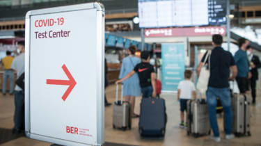 A sign pointing to a test centre at the Berlin Brandenburg Airport, pictured on 28 July 2021