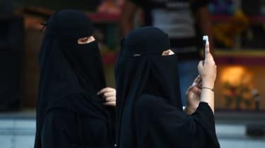 wd-saudi_women_phone_-_fayez_nureldineafpgetty_images.jpg