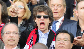 Mick Jagger watches England play football
