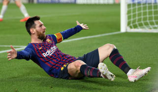 Barcelona star Lionel Messi celebrates his stunning free-kick against Liverpool