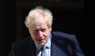 Boris Johnson, U.K. prime minister, prepares to welcome Juri Ratas, Estonia's prime minister, not pictured, ahead of their meeting at number 10 Downing Street in London, U.K., on Tuesday, Aug