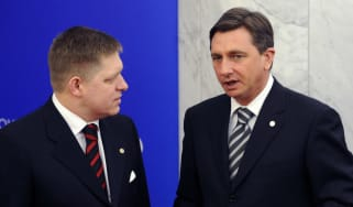 Slovakian Prime Minister Robert Fico (L) talks with Slovenian Prime Minister Borut Pahoron, who has called an early election