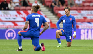 England players Kalvin Phillips and Jack Grealish take the knee before the match against Romania