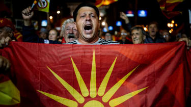 A boycott supporter takes to the streets in Skopje to celebrate the low turnout