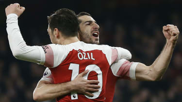 Henrikh Mkhitaryan celebrates a goal with Arsenal team-mate Mesut Ozil
