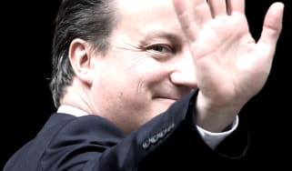 LONDON, ENGLAND - MAY 10:British Prime Minister David Cameron waves as he enters Number 10 Downing Street on May 10, 2012 in London, England. Andy Coulson, a former editor of the News of the