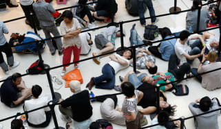 Chinese consumers queue up for the latest Apple iPhone in Beijing
