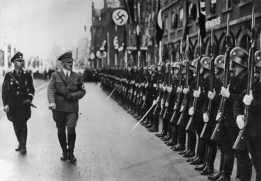 circa 1938:German dictator Adolf Hitler (1889 - 1945) and his chief of police Heinrich Himmler (1900 - 1945) inspecting the SS Guard.(Photo by Hulton Archive/Getty Images)