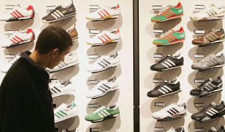 A man looks at Adidas shoes