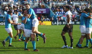 Uruguay players celebrate their victory over Fiji in Rugby World Cup pool D