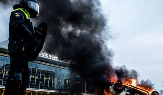 A car burns during anti-lockdown protests in Eindhoven in January